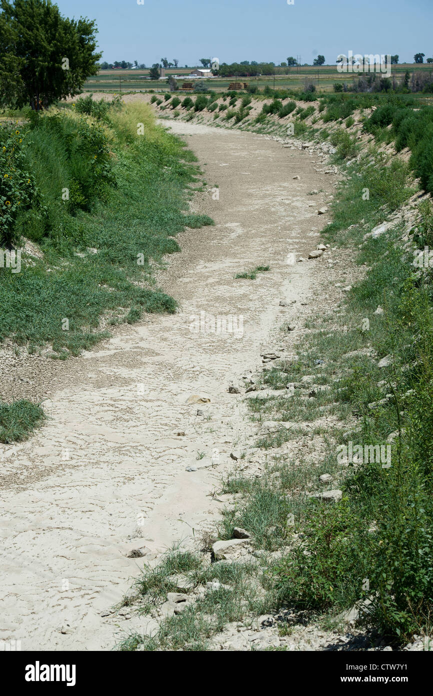 Amity Canal went dry due to drought in Lamar, Colorado. Stock Photo