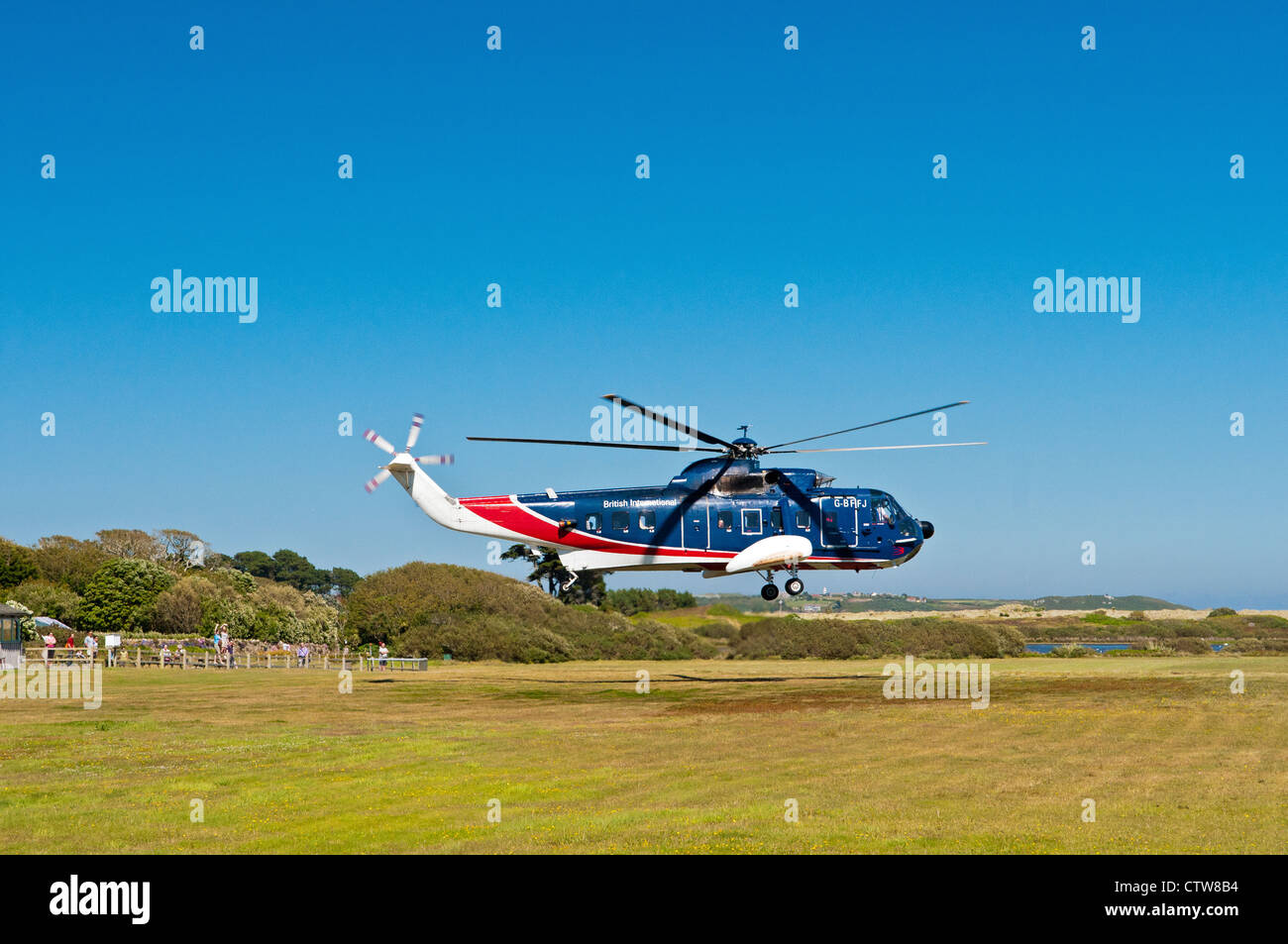 British International Helicopter taking off from Tresco, Scillies. NOTE: this service ended October 2013 - Stock Image