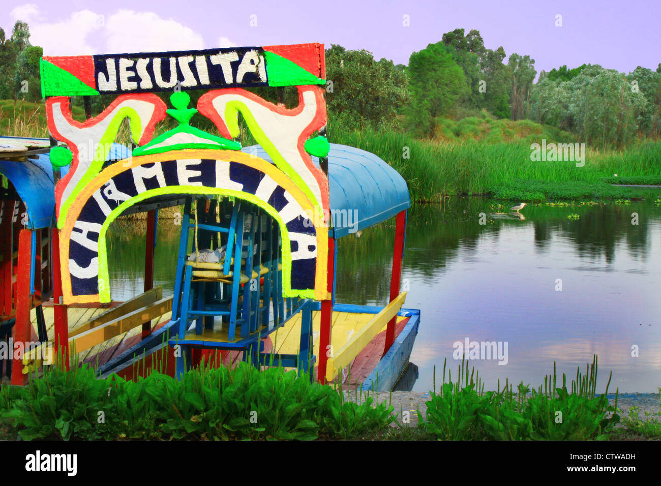 Colorful Mexican gondola at Xochimilco's Floating Gardens in Mexico City. - Stock Image
