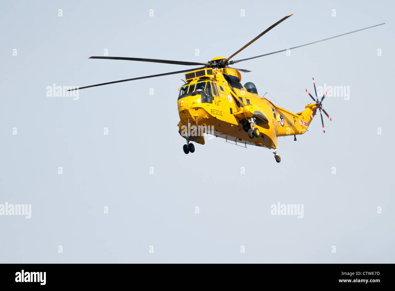 Yellow Air sea rescue helicopter in the air. Stock Photo