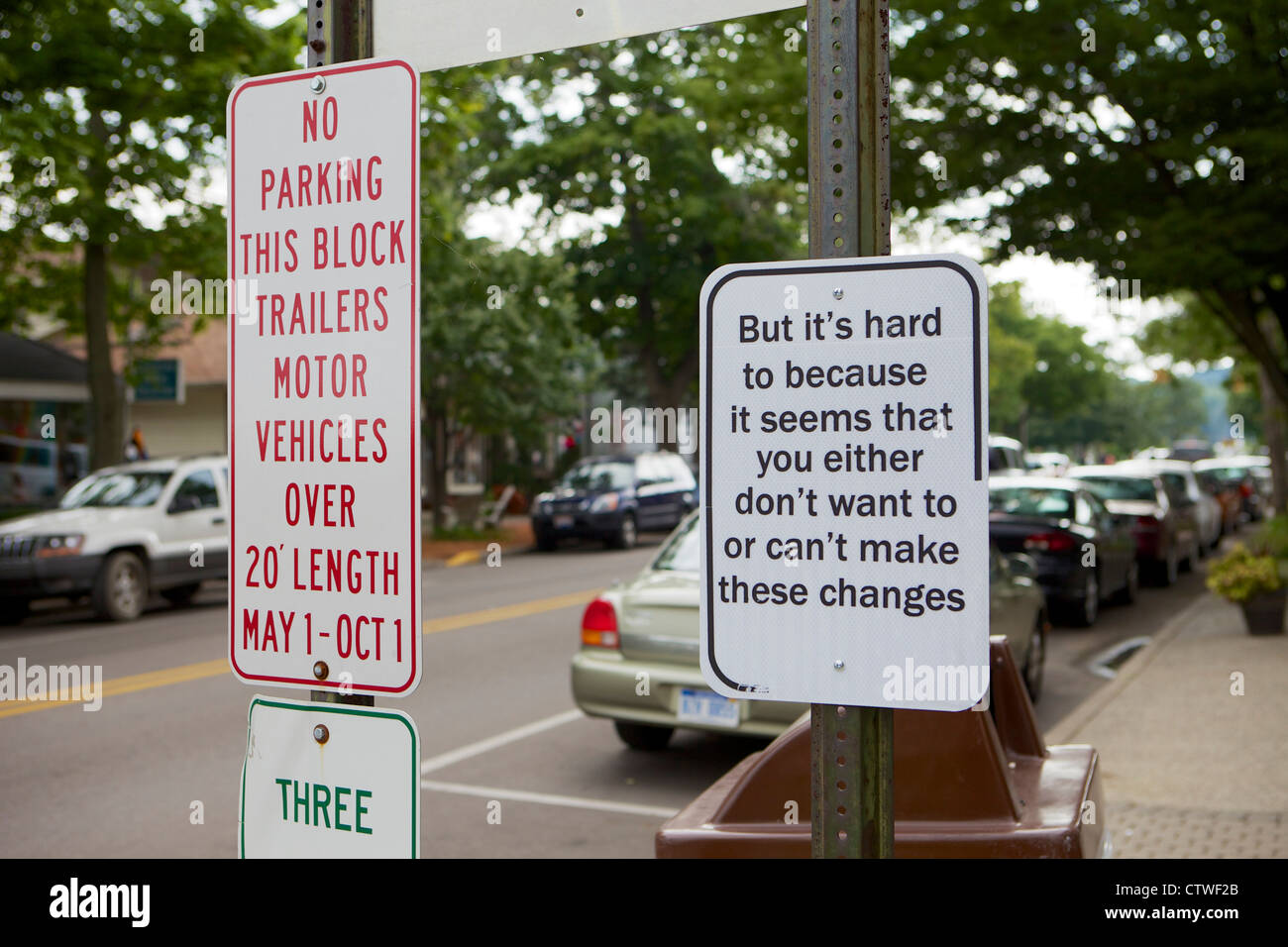 Humorous  street sign commenting on human resistance to change - Stock Image