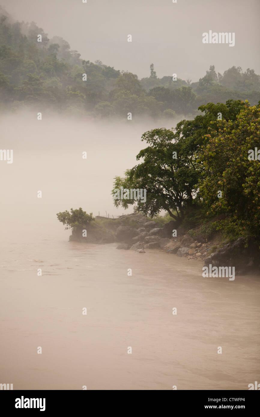 India Ganges river Rishikesh yoga Hinduism sacred meditation fog landscape water nature mornig nord tourism religion - Stock Image