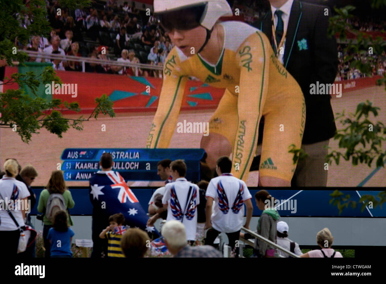 A lone Australian spectator with the national flag on the person's back in the Olympic Park, near the Velodrome, - Stock Image