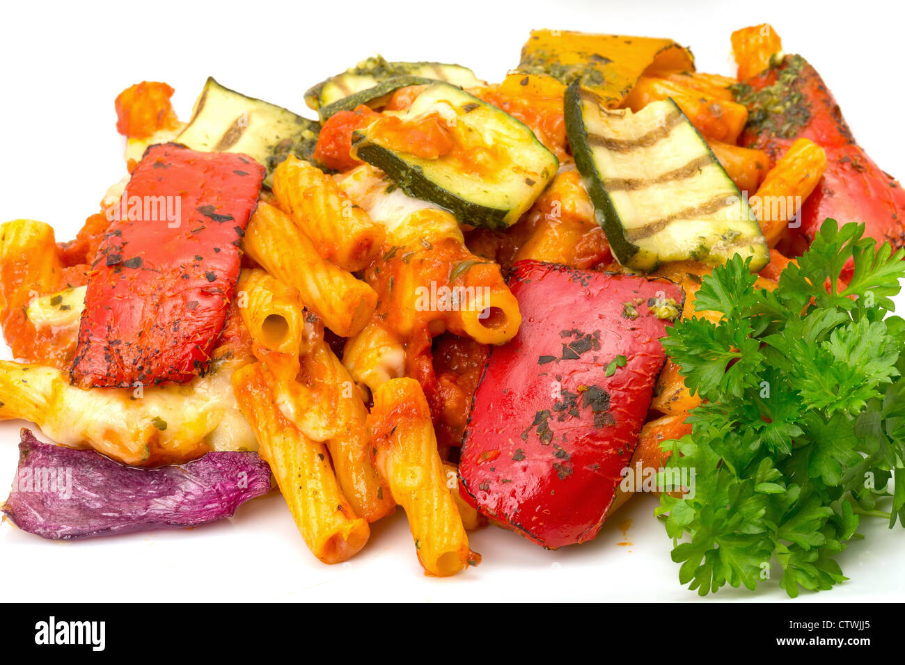 Vegetable pasta bake close-up - studio shot with a white background - Stock Image