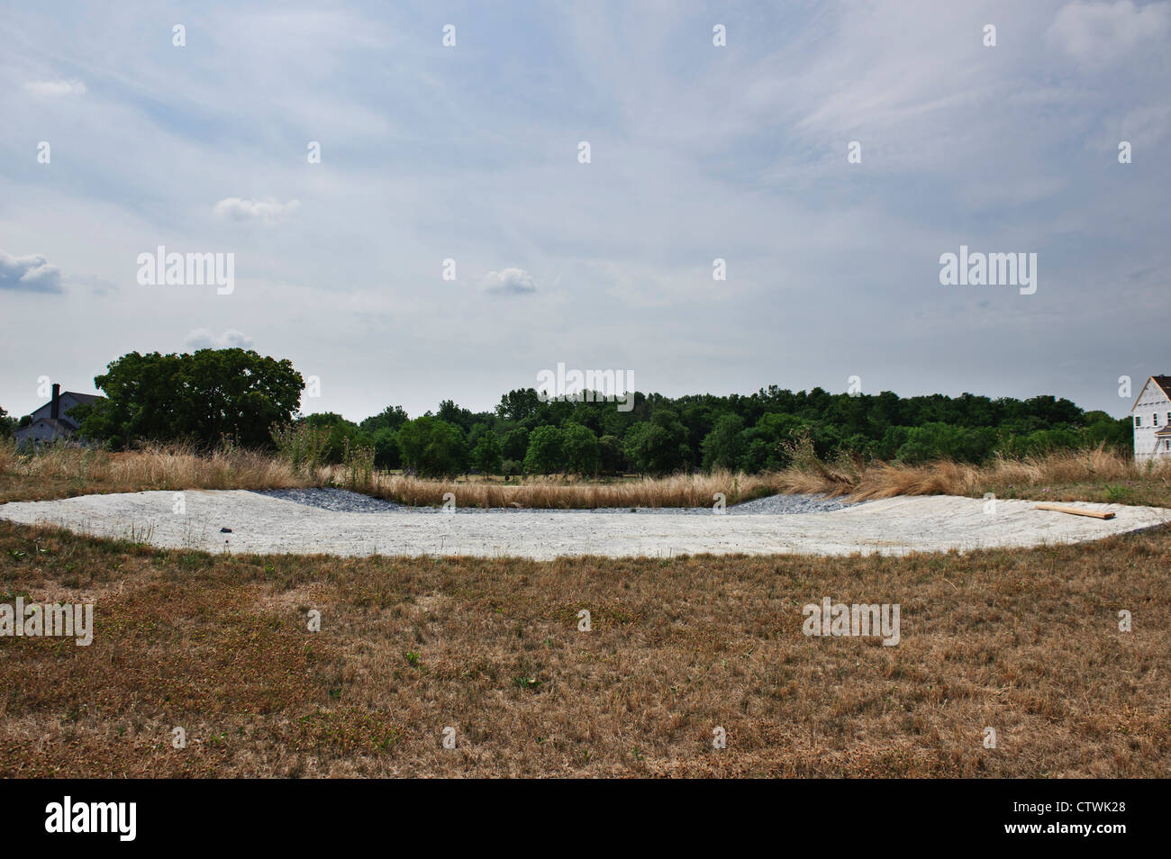 OVERFLOW SPILLWAY TO ACTIVE SETTLING BASIN - Stock Image