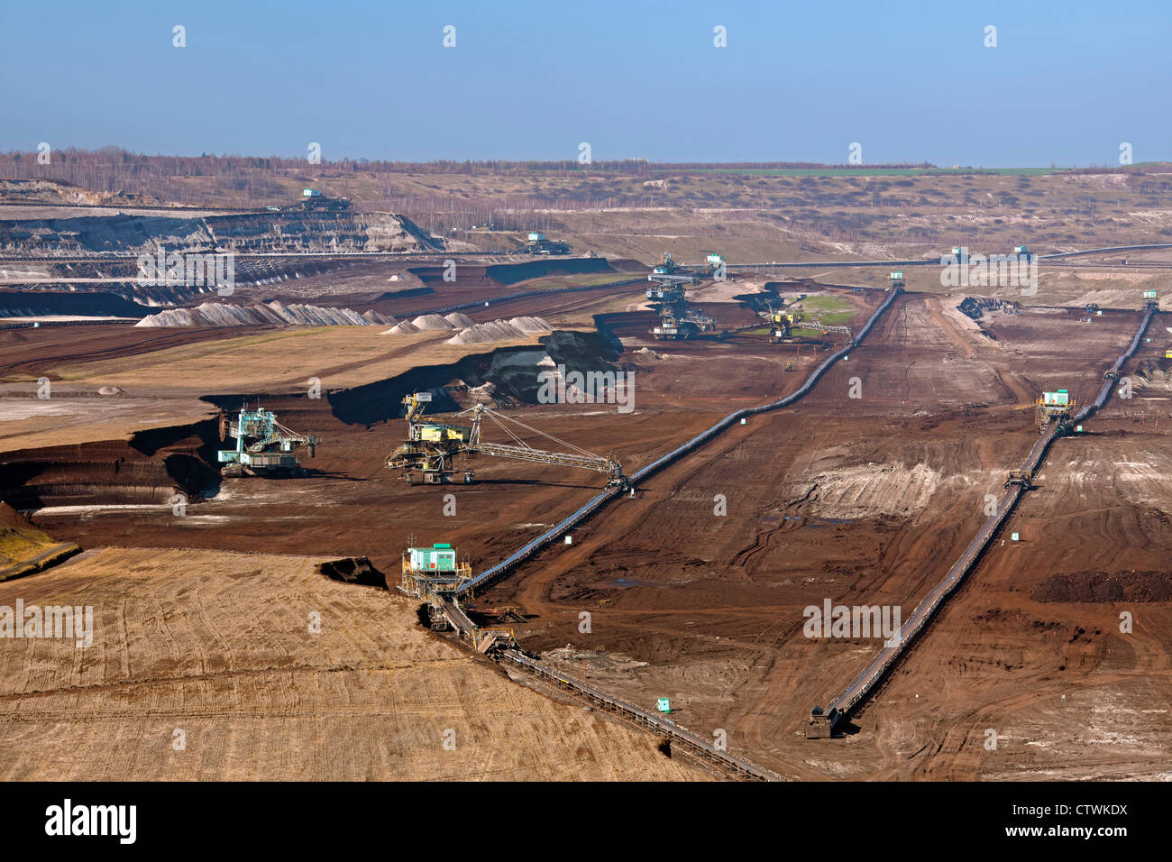 Brown coal / lignite being extracted by huge bucket-wheel excavators at open-pit mine, Saxony-Anhalt, Germany - Stock Image