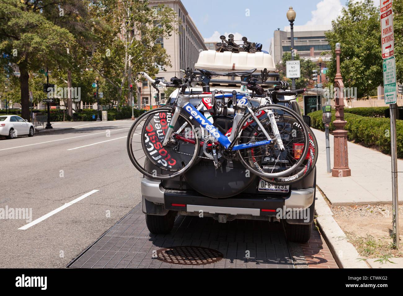 Bicycles on rear mounted bike rack - USA - Stock Image