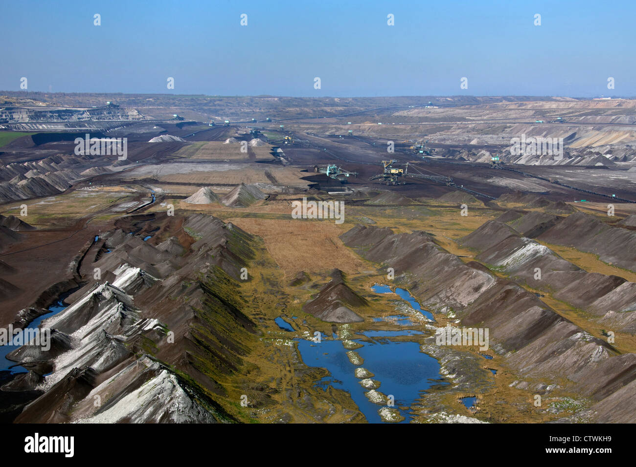 Spoil heaps and brown coal / lignite being extracted by huge bucket-wheel excavators at open-pit mine, Saxony-Anhalt, - Stock Image