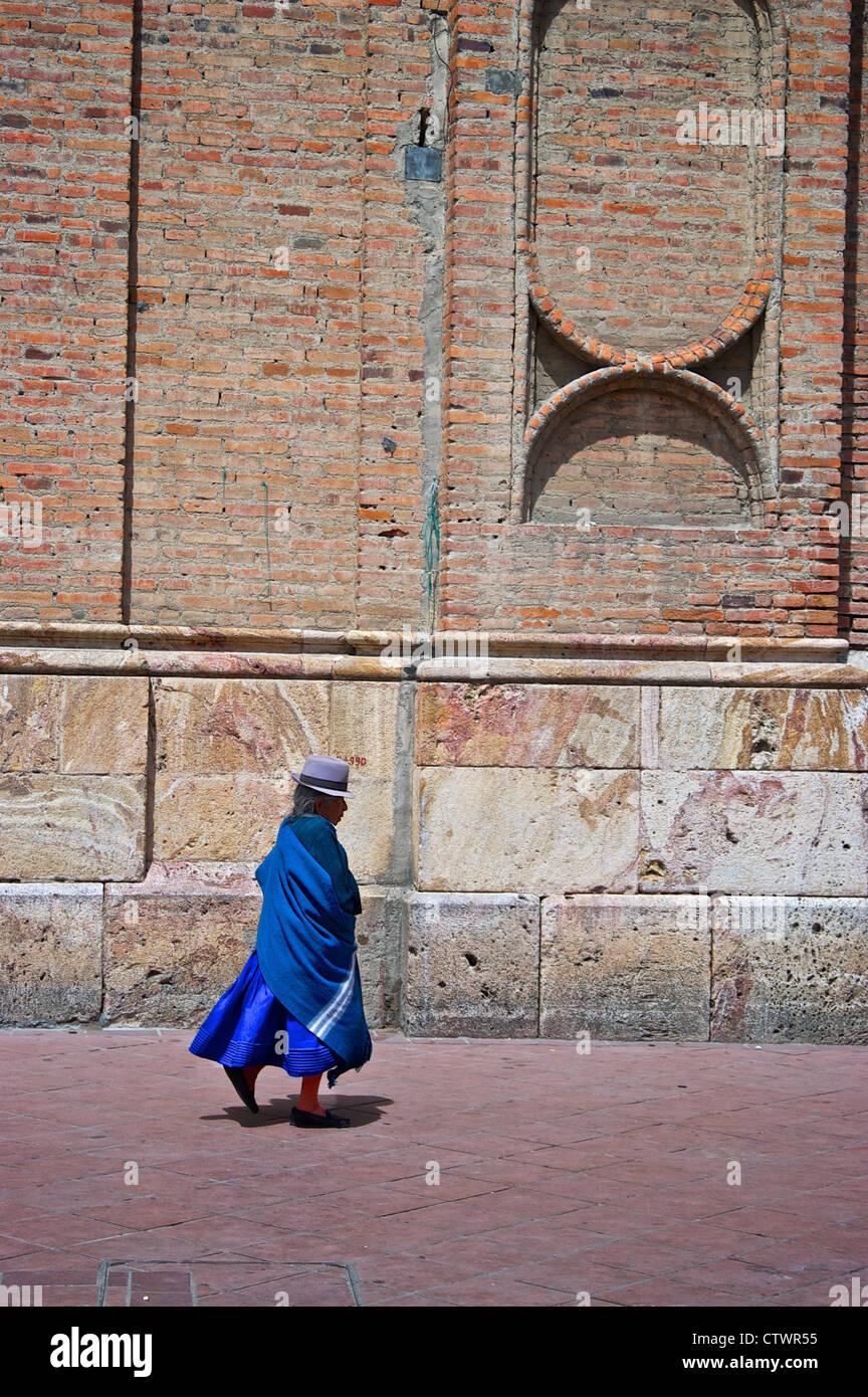 Old woman walking down the street of Cuenca, Ecuador. - Stock Image