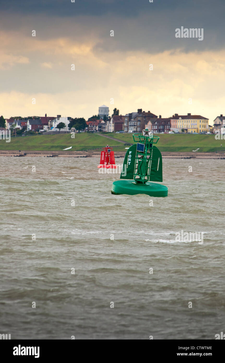 Green and red navigate marker buoys at sea - Stock Image