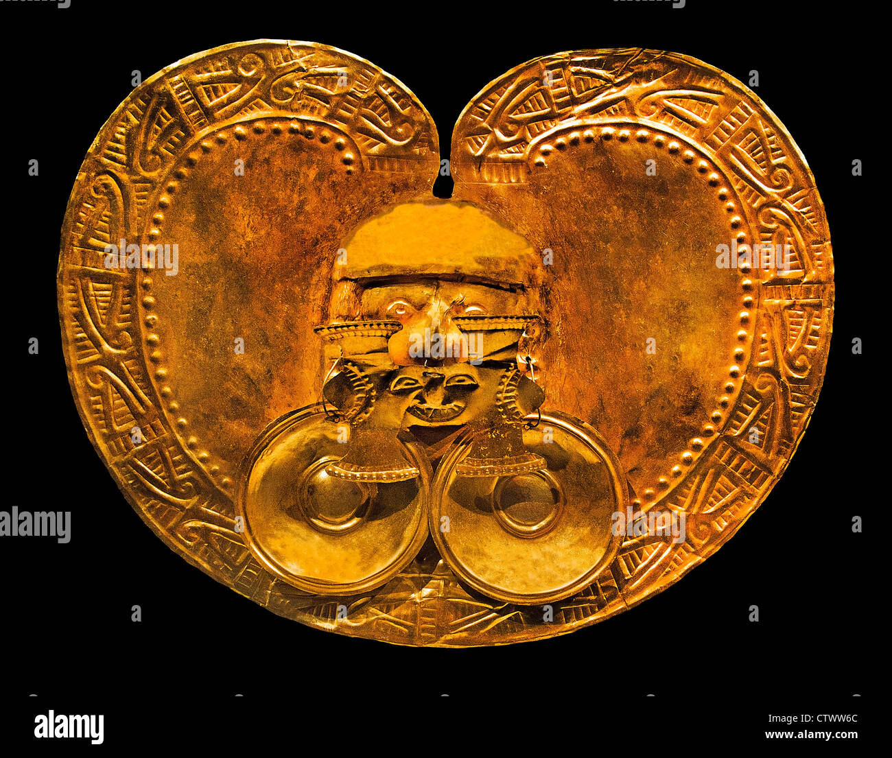 Pectoral with Face 1–7 century Colombia Culture Calima - Yotoco Gold H. 8 3/4 x W. 11 x D. 1 3/8 in. (22.2 x 27.9 - Stock Image