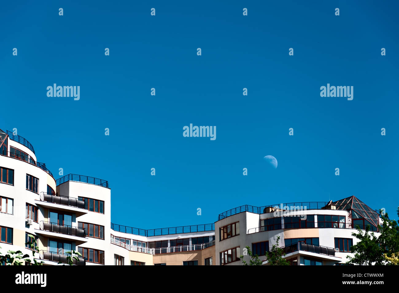 Modern house on a background of blue sky and the moon - Stock Image