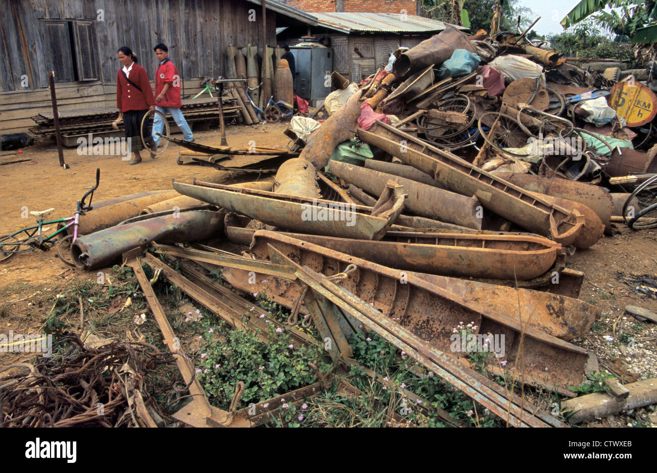 War Waste and Scrap Metal of US Cluster Bombs or Bomb Casings Piled up in Scrap Yard Phonsavan Xieng Khuang Laos Stock Photo