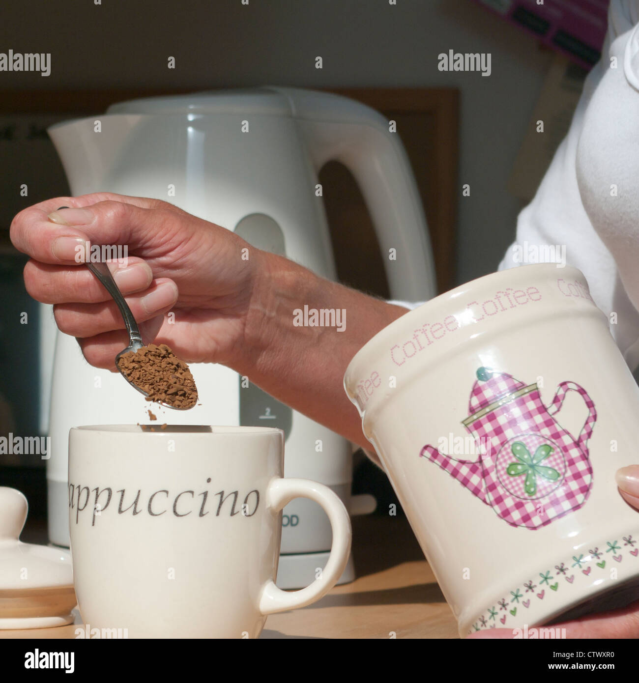 Woman Person Making A Cup Of Coffee Putting A Teaspoon Spoonful Of