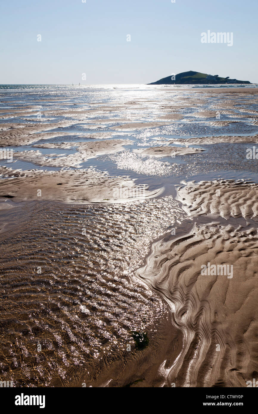 Sand patterns and the incoming tide at Bantham, Devon - Stock Image