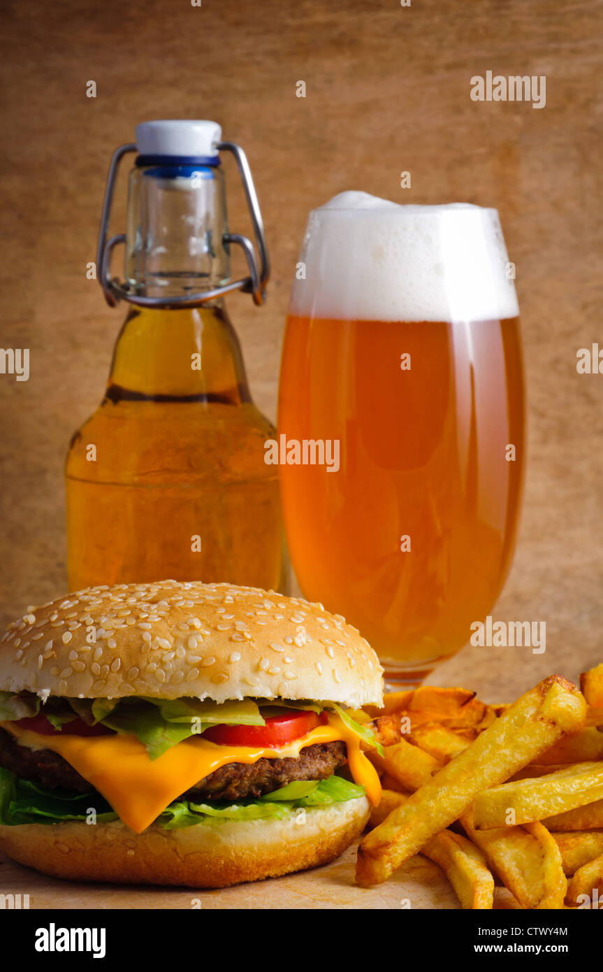 Fast food hamburger menu with french fries and beer - Stock Image