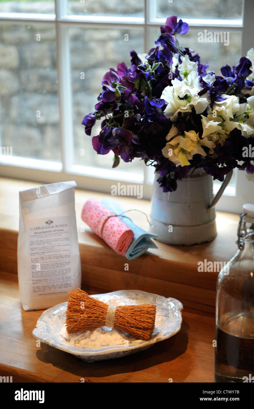 Traditional cottage interior with a vase of flowers UK - Stock Image