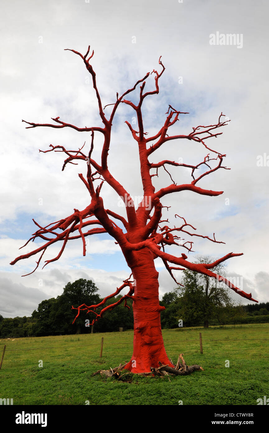 An art installation by Philippa Lawrence 'Bound, Croft' created by wrapping a dead oak tree in cotton near - Stock Image