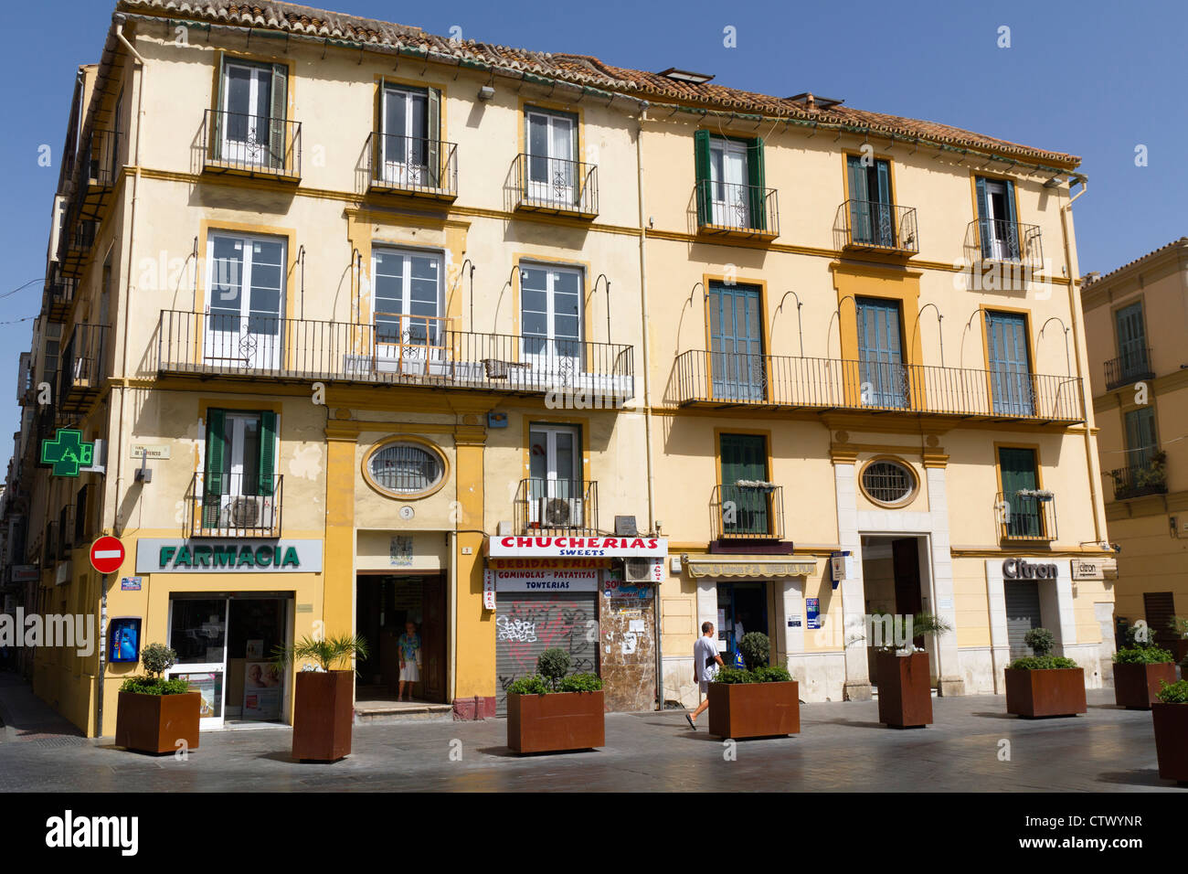 Malaga old town stock photos malaga old town stock for Apartments with shops below