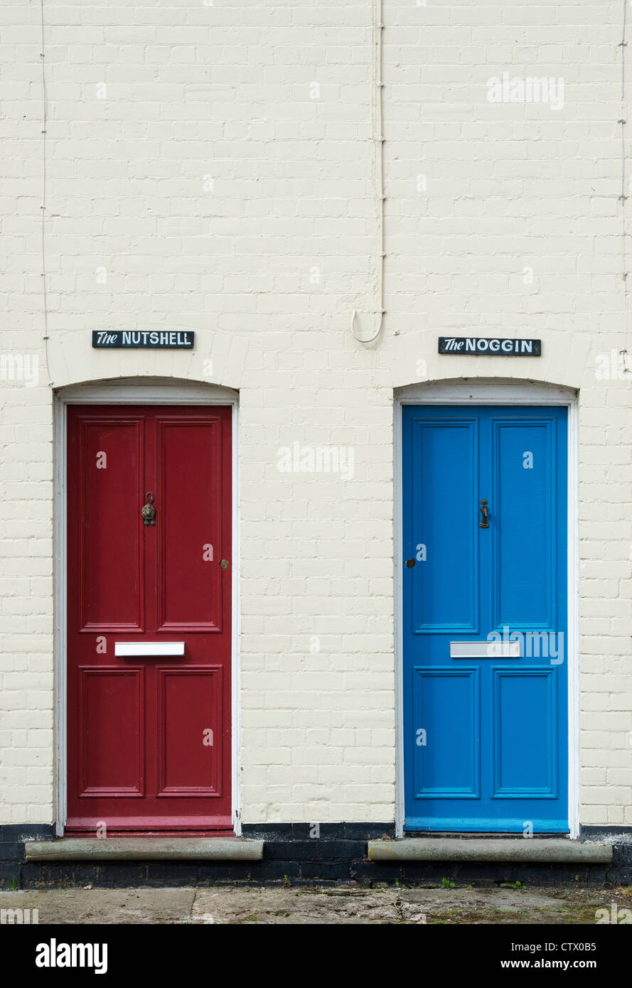 Quirky english colourful front doors and house names. The Noggin and the Nutshell. Eardisland. Herefordshire, England - Stock Image