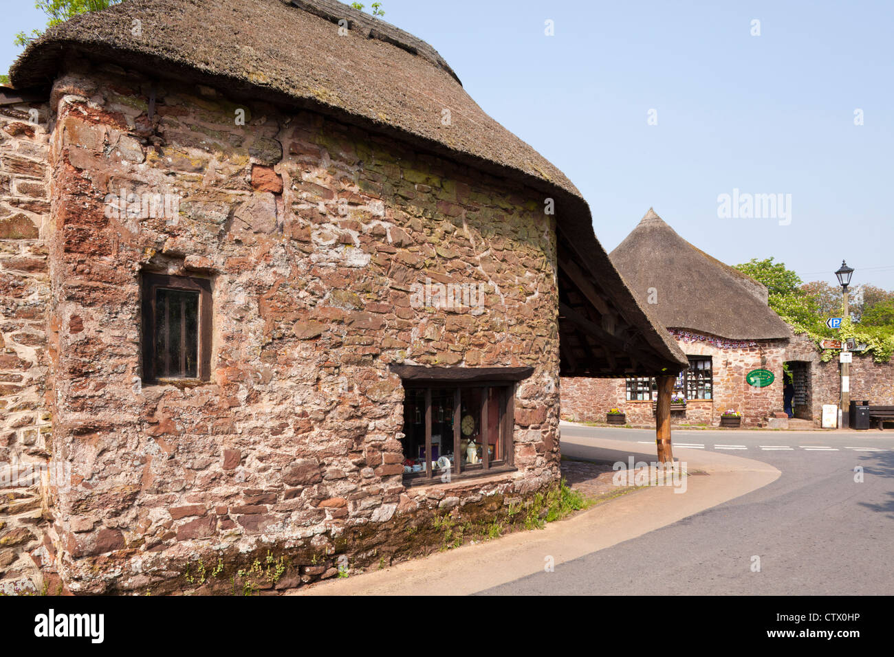 The famous thatched Cockington Forge dating from the 14th century in the village of Cockington, Devon - Stock Image
