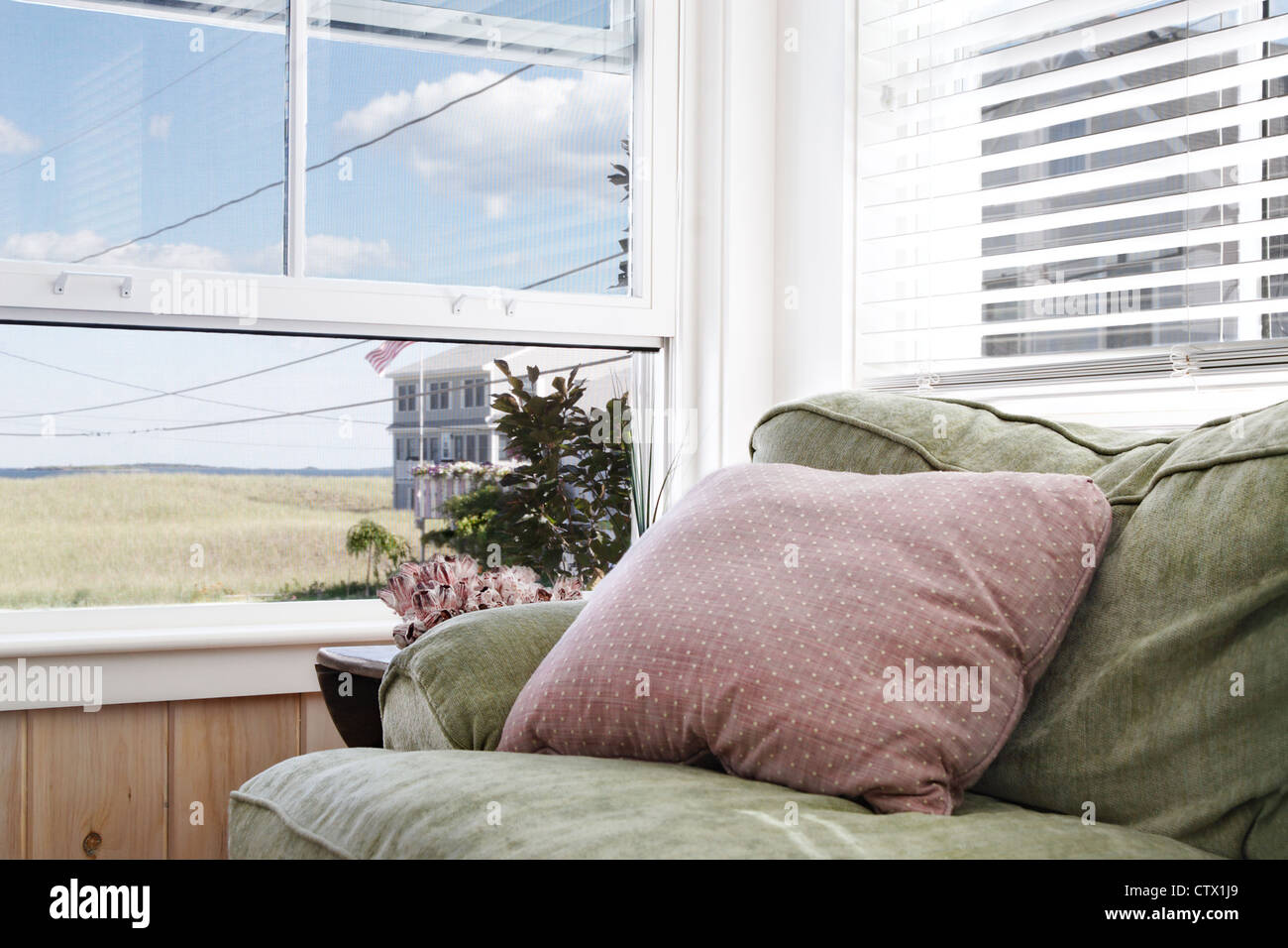 Plush comfy sofa from which to enjoy the ocean view - Stock Image