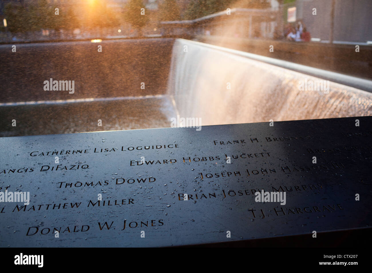Wind picks up water and mist around the south pool at the 9-11 Memorial in New York City. - Stock Image