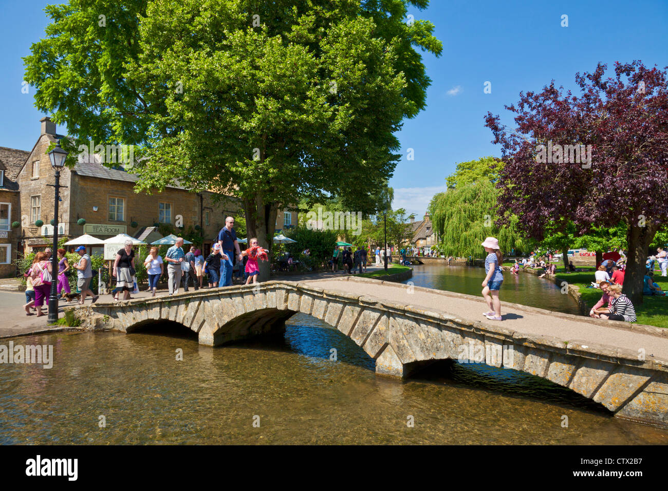 Bridge over the River Windrush in Bourton on the Water Cotswolds Gloucestershire England UK GB EU Europe - Stock Image