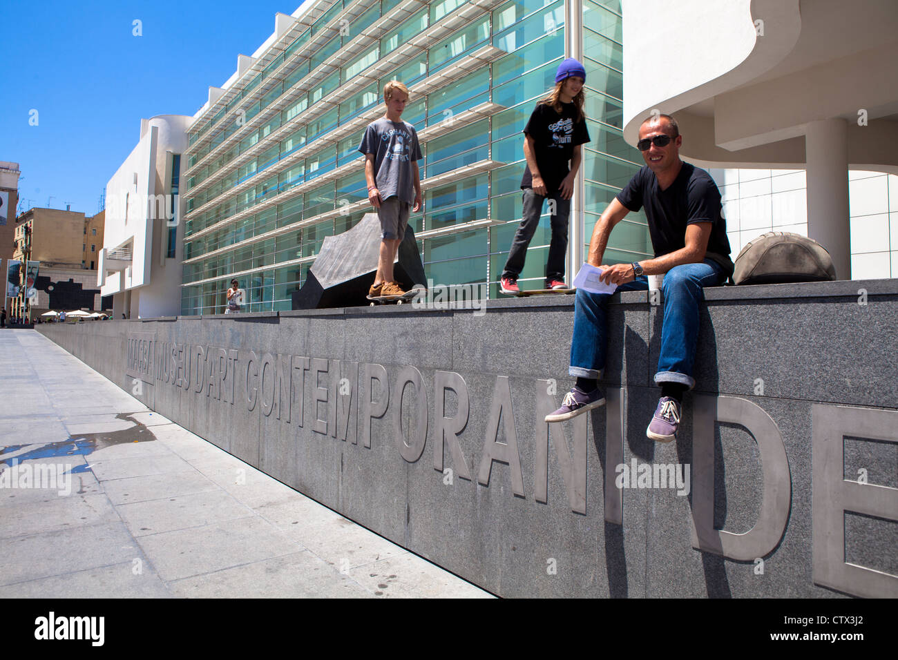 Boys skateboarding outside MACBA contemporary art Museum Barcelona Spain - Stock Image
