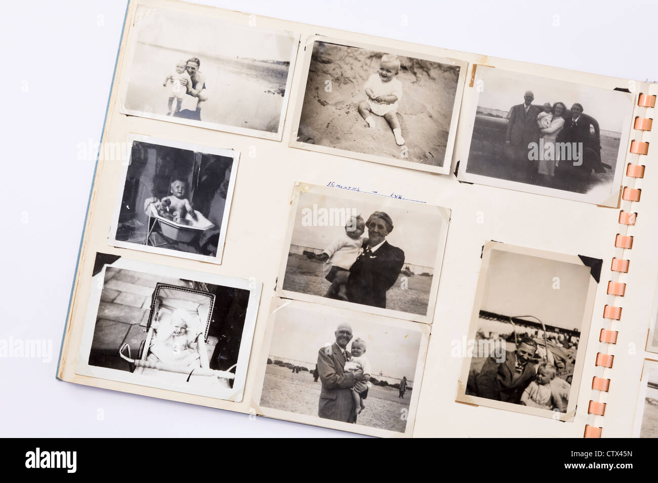 Old faded black and white printed photographs in a family photograph album from 1950s era with page showing photos - Stock Image