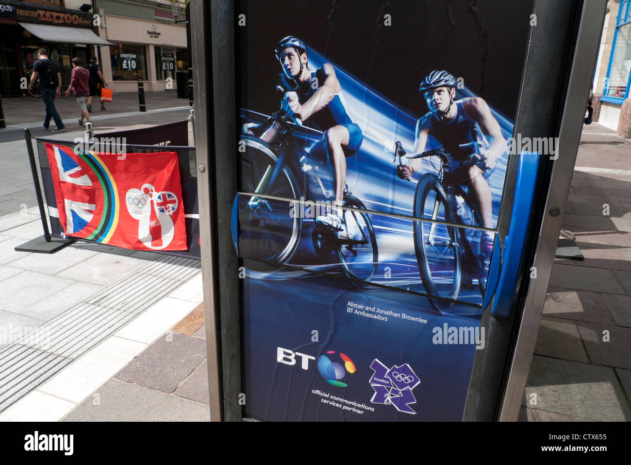 2012 London Olympics Brownlee brothers cycling sponsorship by BT British Telecom on phone boxes in Cardiff  UK  - Stock Image