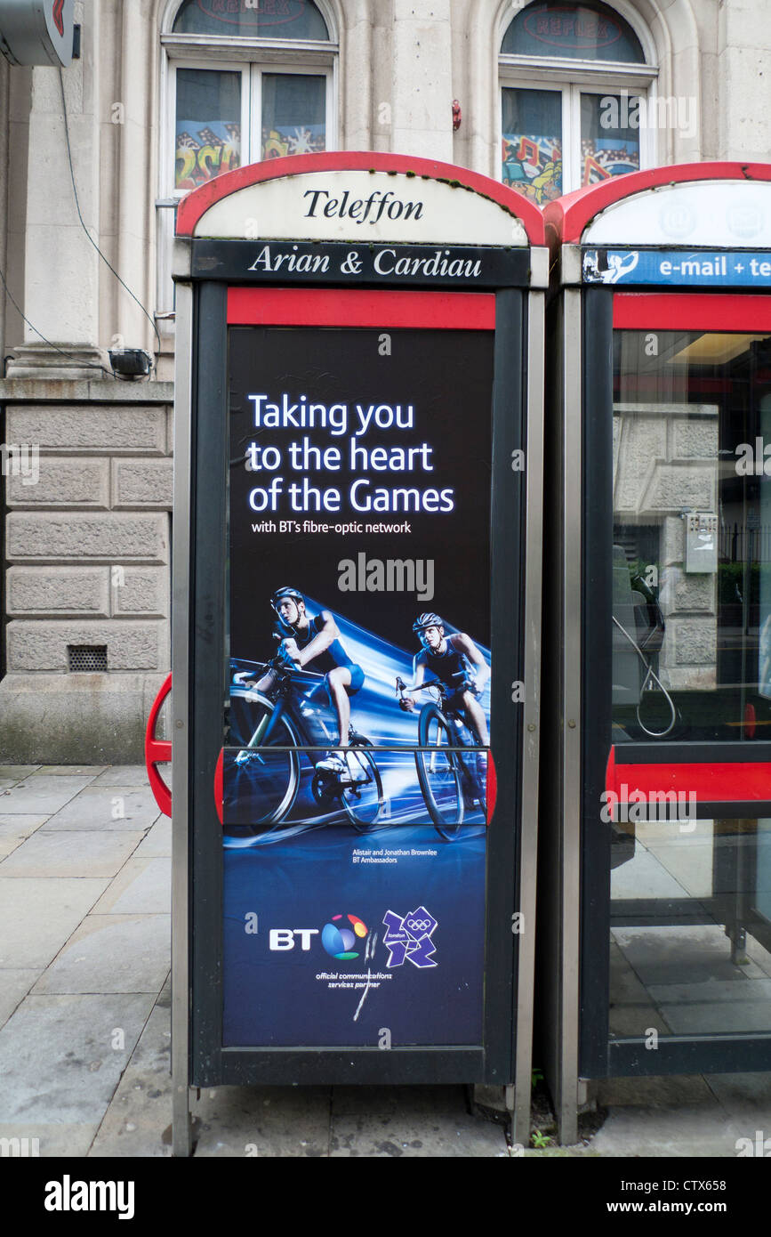 2012 London Olympics Brownlee brothers cycling sponsorship by BT British Telecom on phone boxes in Cardiff City - Stock Image
