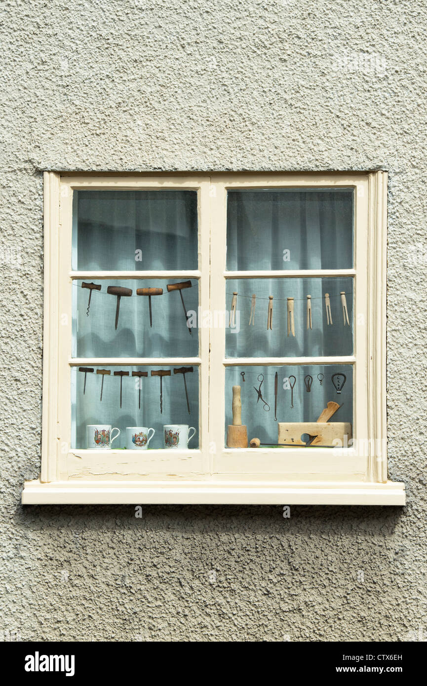 Household Antiques in a house window. Pembridge. Herefordshire. England - Stock Image