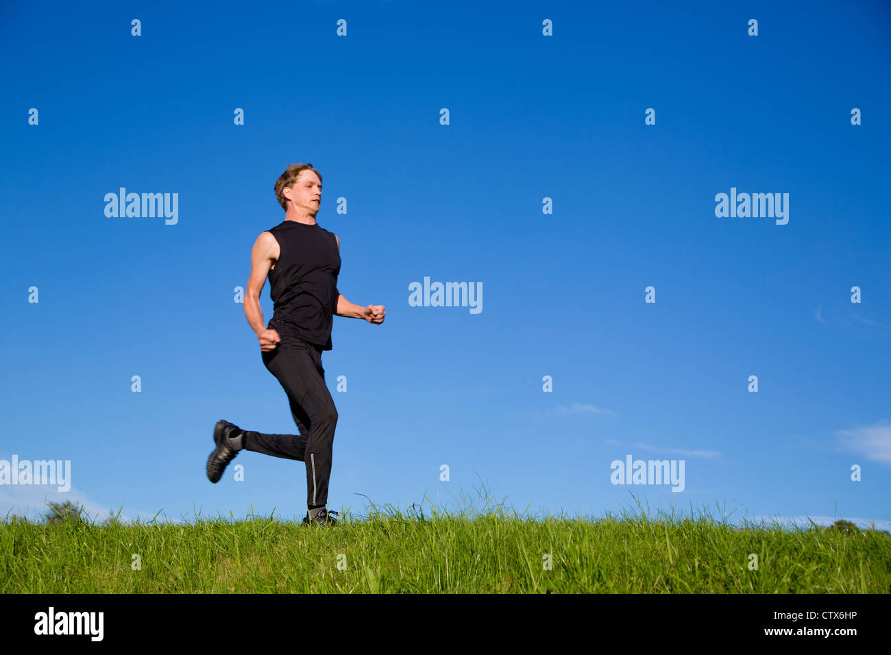 All muscles of sportsman is strained on exercise - Stock Image