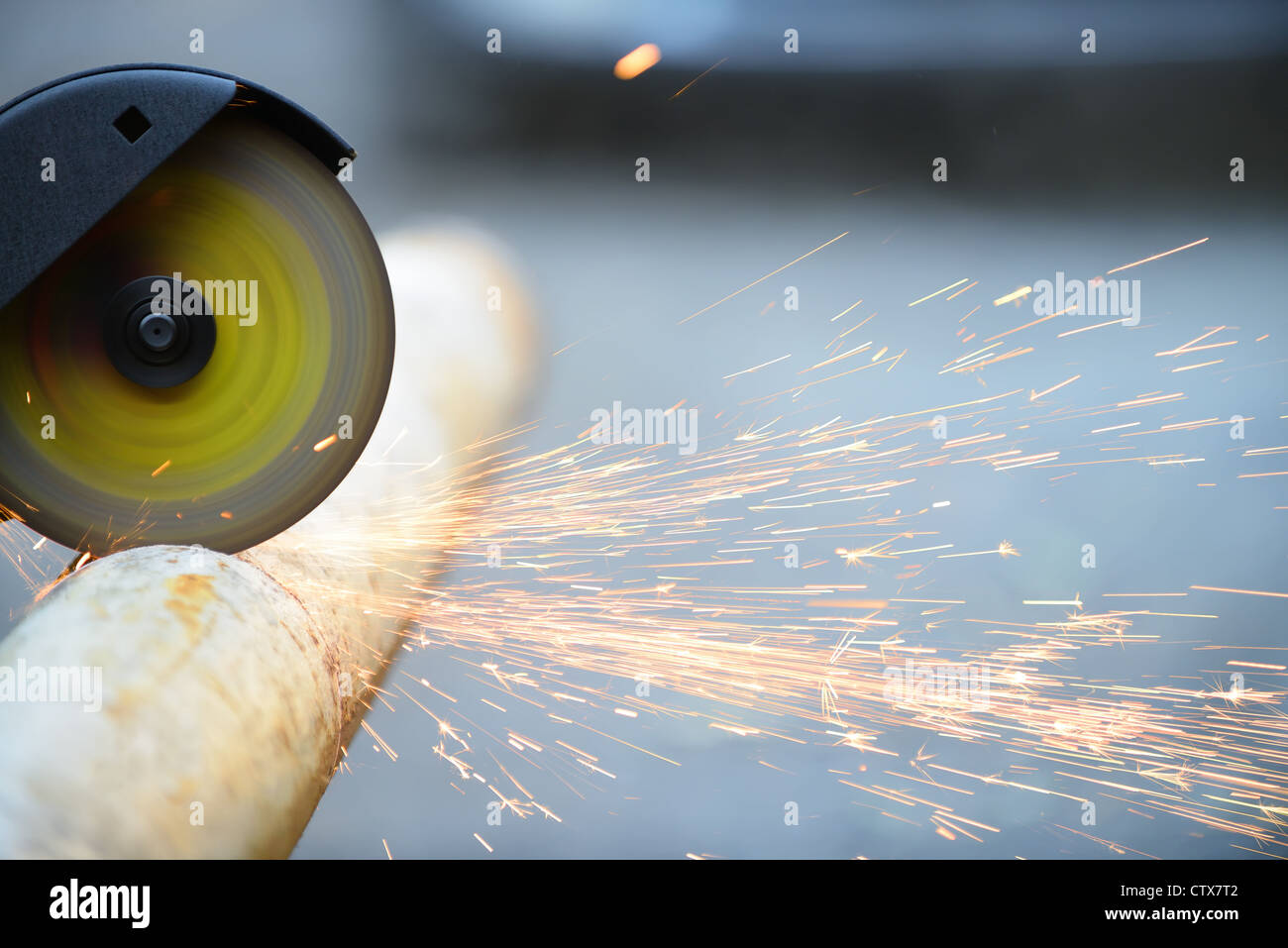 Cutting metal angle grinder, sparks from the disk. Photo close-up - Stock Image