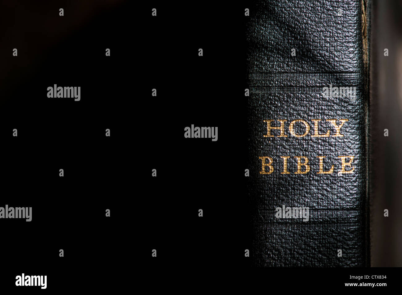 Holy Bible against a dark background - Stock Image