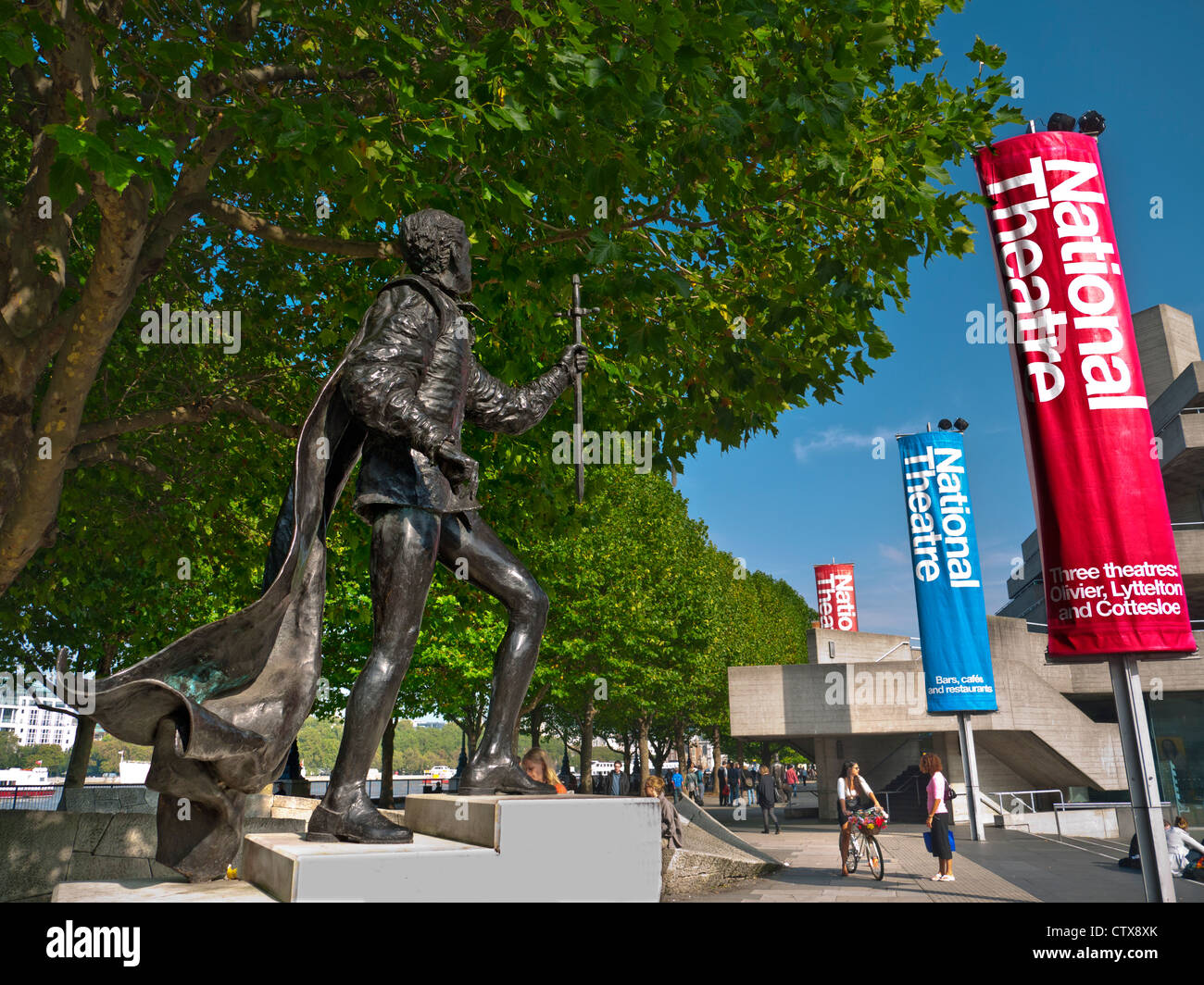 National Theatre and bronze statue of Lord Laurence Olivier  South Bank River Thames London UK - Stock Image