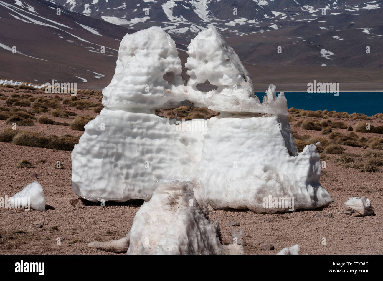 Snow sculptured by wind front of Laguna Miscanti Reserva National Los Flamencos Atacama Andes North Chile October - Stock Image