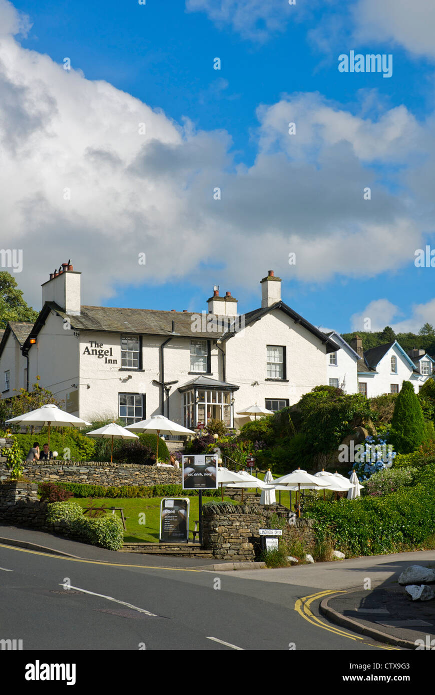 People sitting in the beer garden of the Angel Inn, Bowness, Lake District National Park, Cumbria, England UK - Stock Image