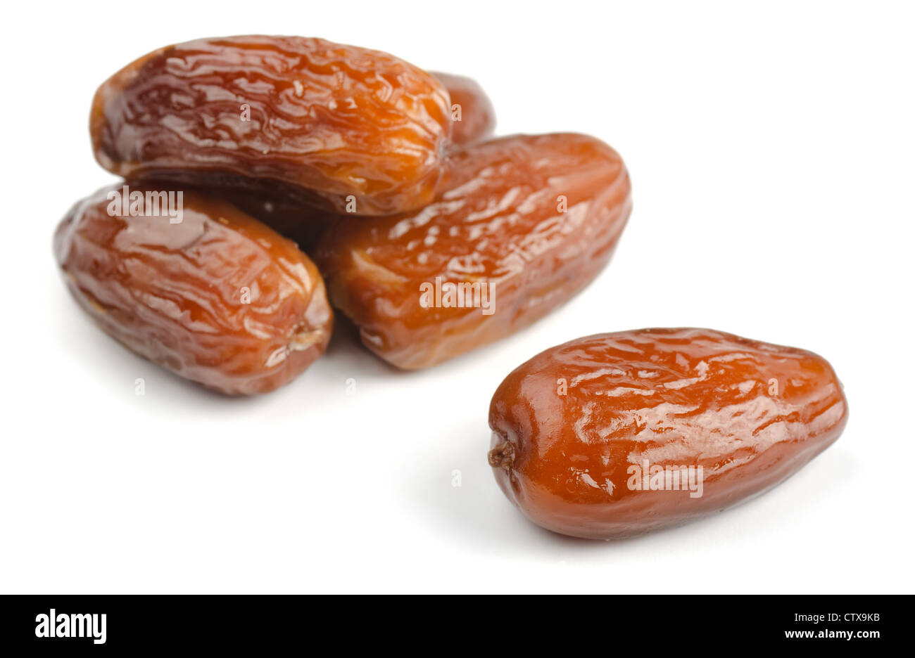 Group of dried date fruits isolated on white - Stock Image
