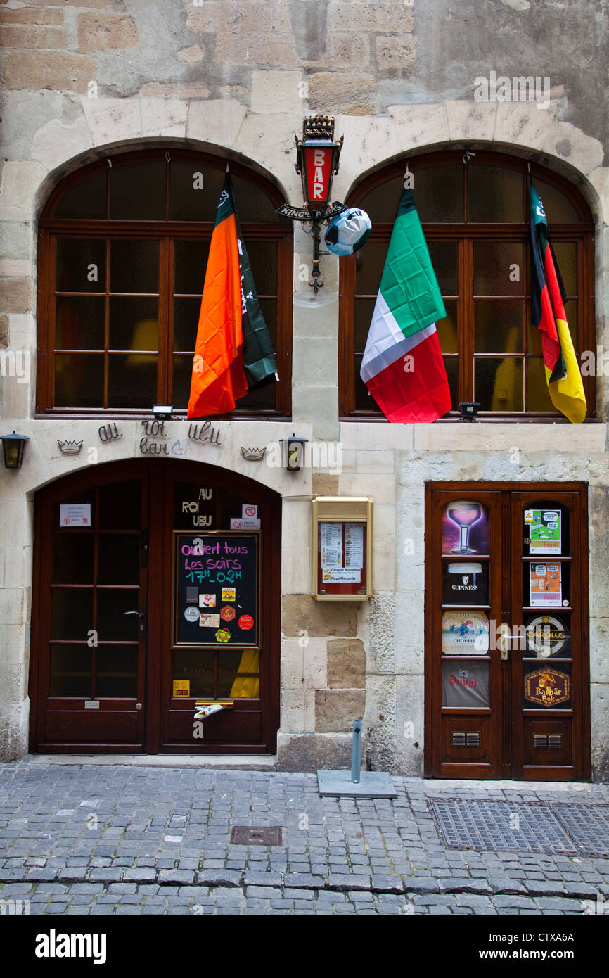 A bar in the old town of Geneva with national flags hanging during the European Football Championship - Stock Image