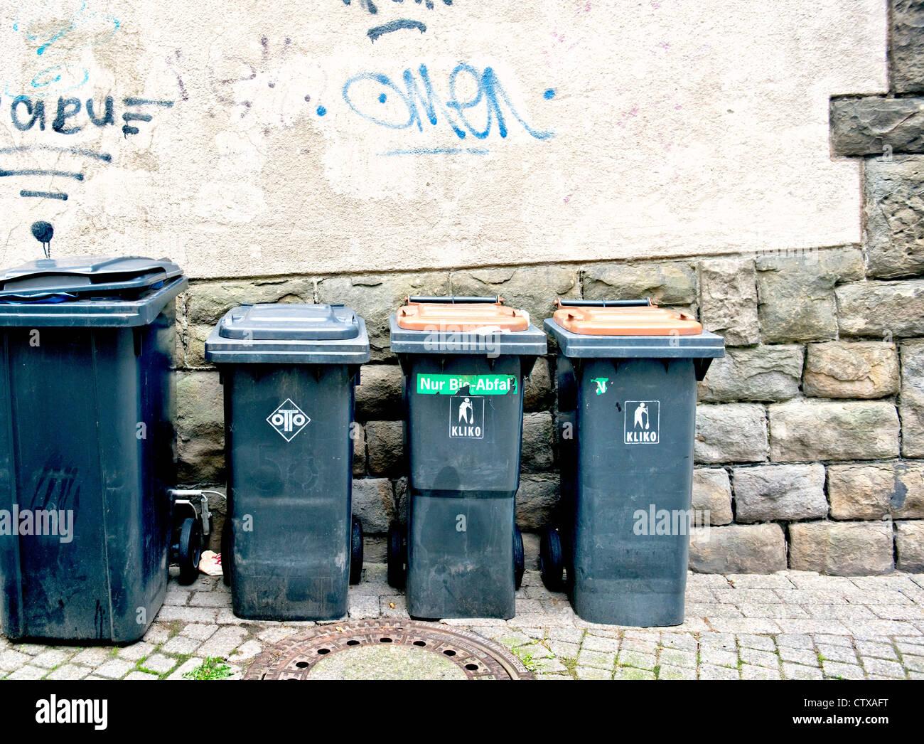 Dust bins in a backyard; muelltonnen im Hinterhof Stock Photo
