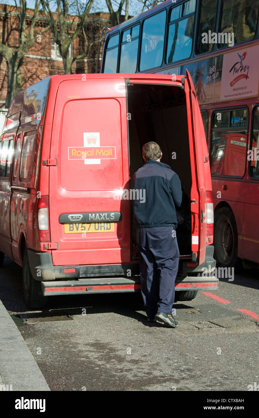 Royal Mail van from rear with doors open and driver Upper Street islington London England UK & Royal Mail van from rear with doors open and driver Upper Street ...