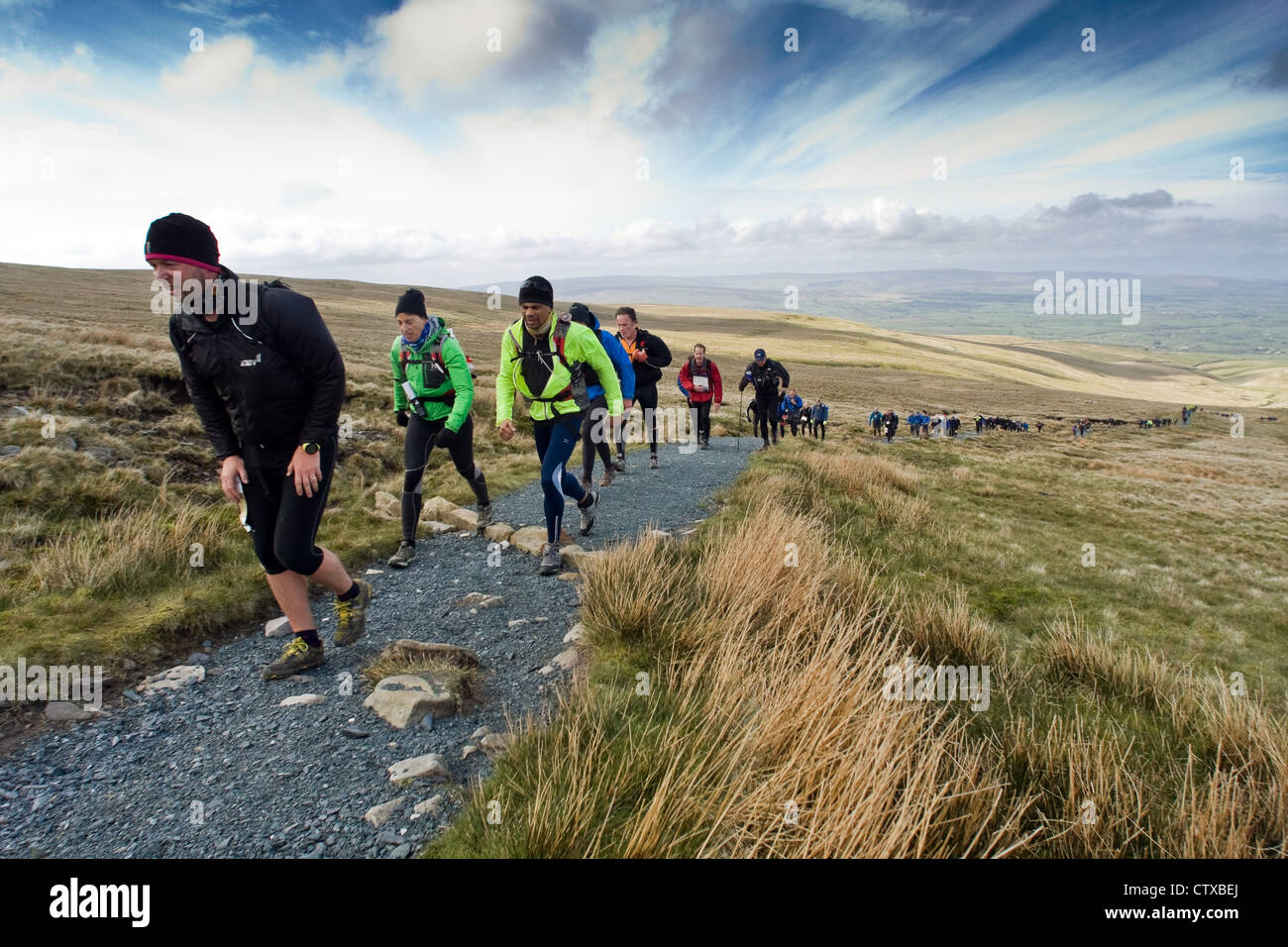 Competitors in the Fellsman tackle the path up Ingleborough - Stock Image