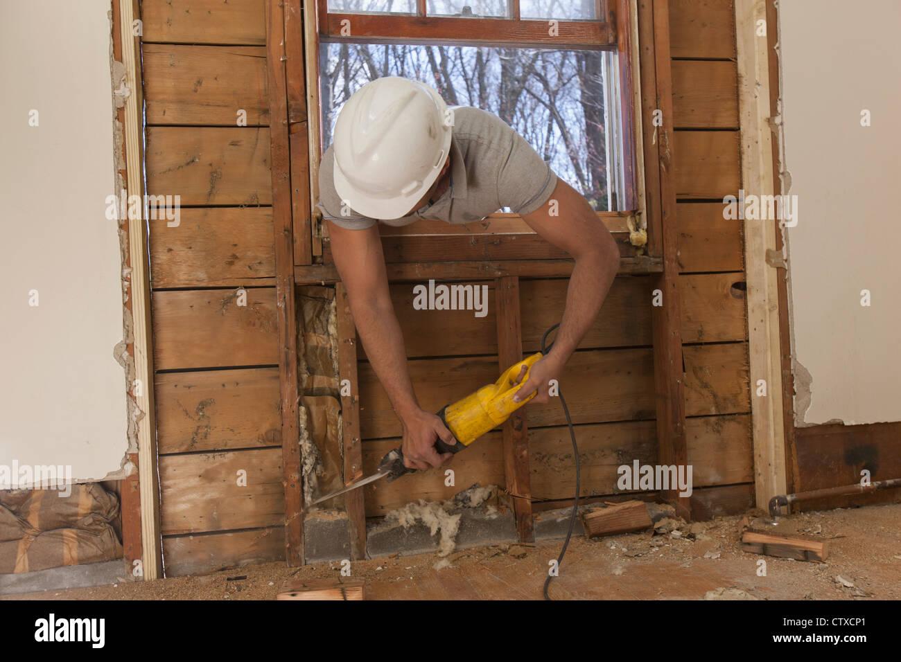 Saw Cutting Through Wall : Reciprocating stock photos images