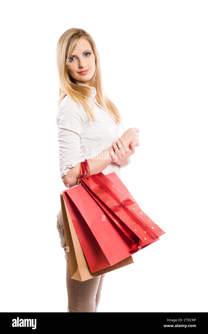 Half length portrait of a beautiful young blond woman with shopping bags. - Stock Image