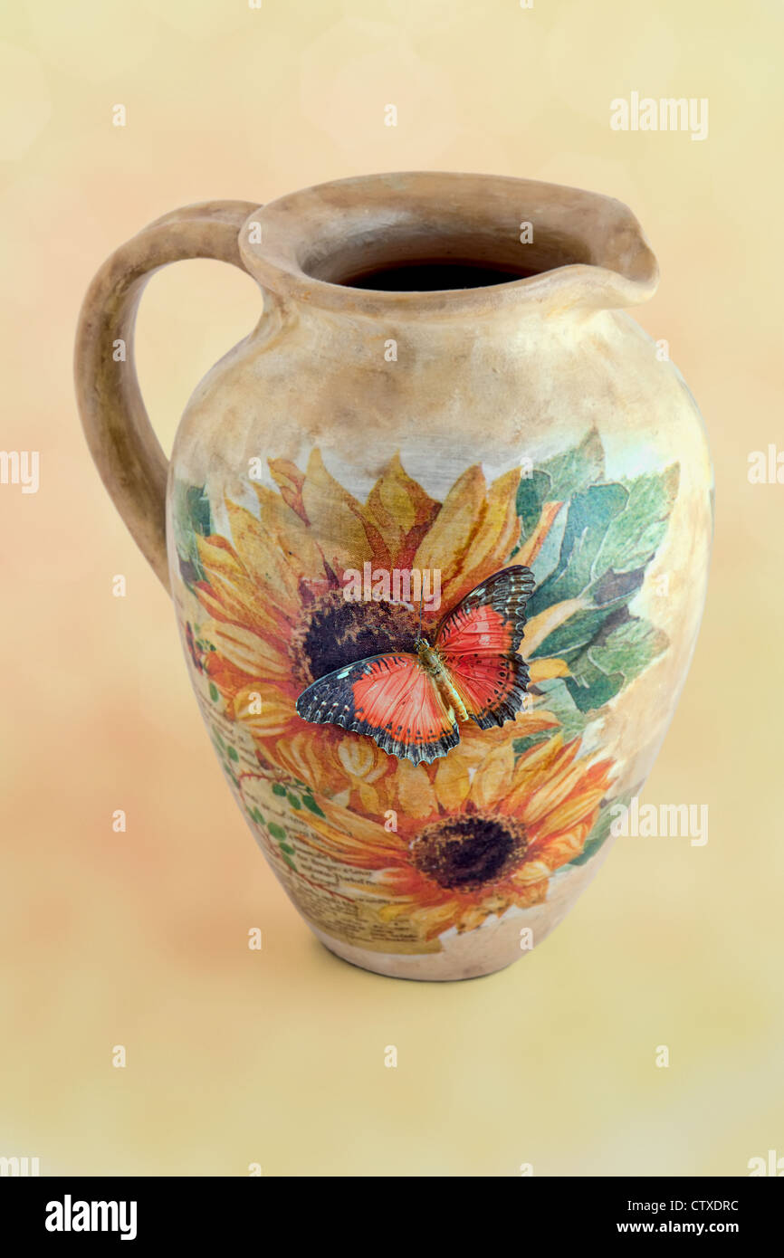 Butterfly on a decoupage jug in floral pattern Stock Photo