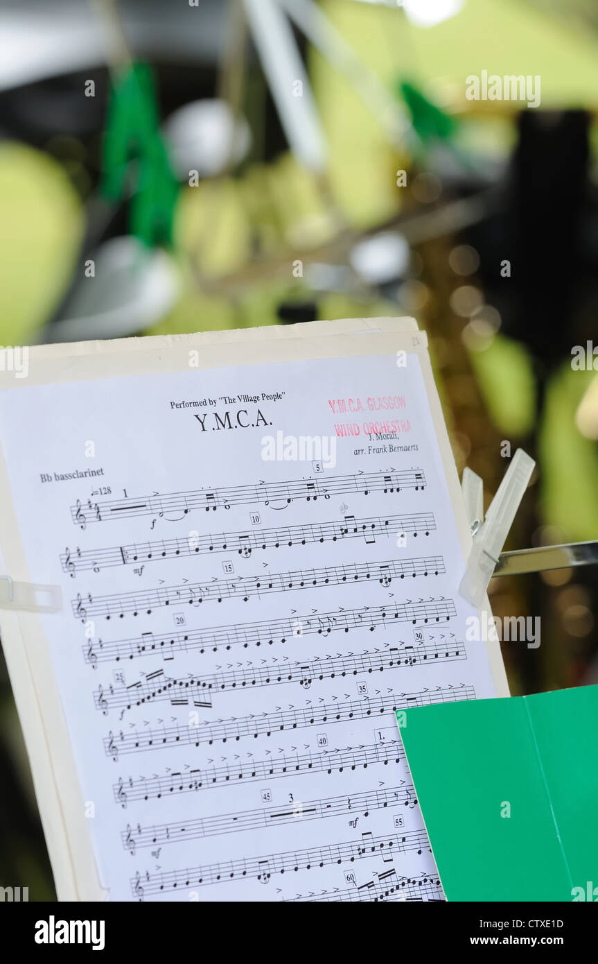 Music sheet on a stand outdoors - Stock Image