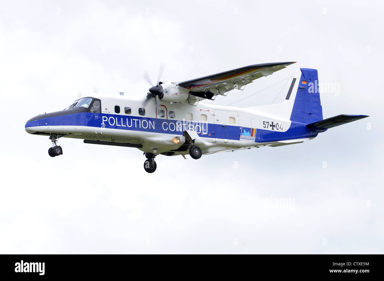 Dornier DO-228-212 pollution control aircraft operated by the German Navy on approach for landing at RAF Fairford - Stock Image