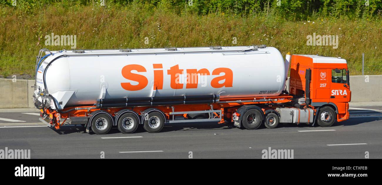 Sitra foodstuff & food supply chain transport specialists articulated bulk tanker trailer and lorry truck driving - Stock Image